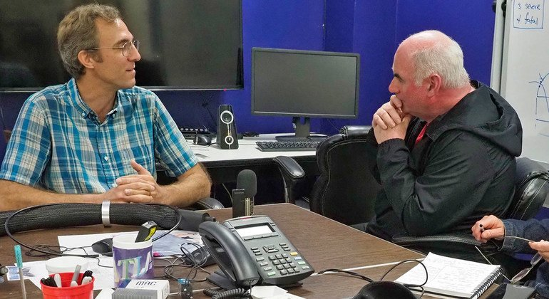 Ari Heinz (left) an astronomer at the the University of Hawaii Institute of Astronomy talks to the International Labour Organization's Kevin Cassidy.