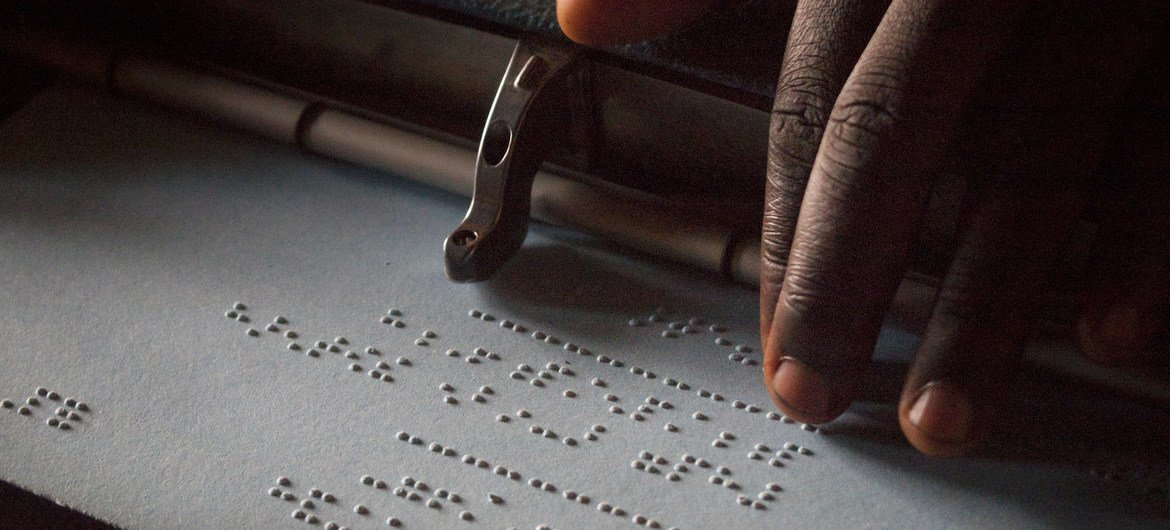 A child reading Braille at a high school in Uganda.