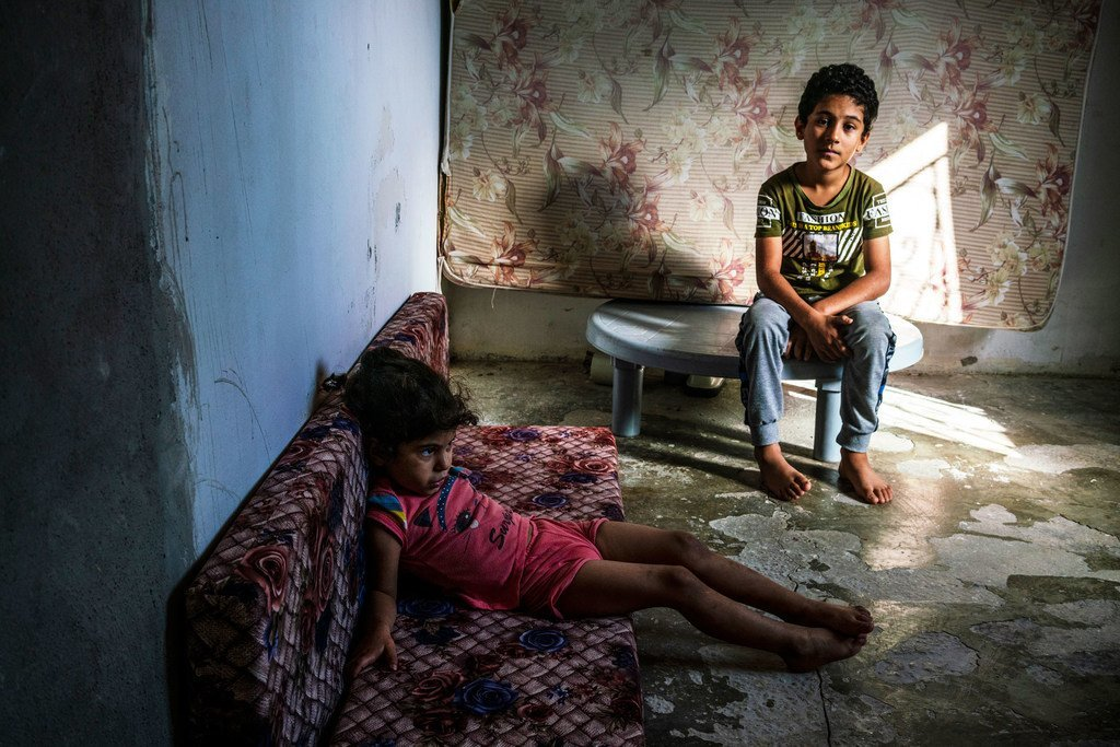 A dire financial situation worsened by increasing debt has driven the family of Syrian refugee siblings to move three times. They currently live in a crumbling house on the side of a graveyard in Jordan.