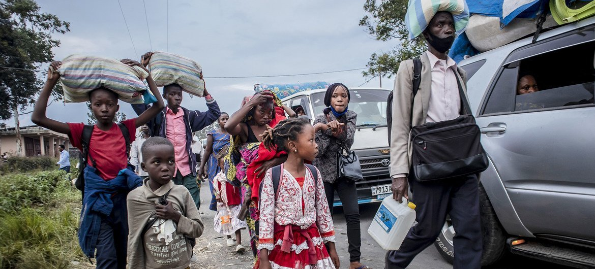 People evacuated from Goma because of the danger of another volcano eruption arrive in Sake, North Kivu province in DR Congo.