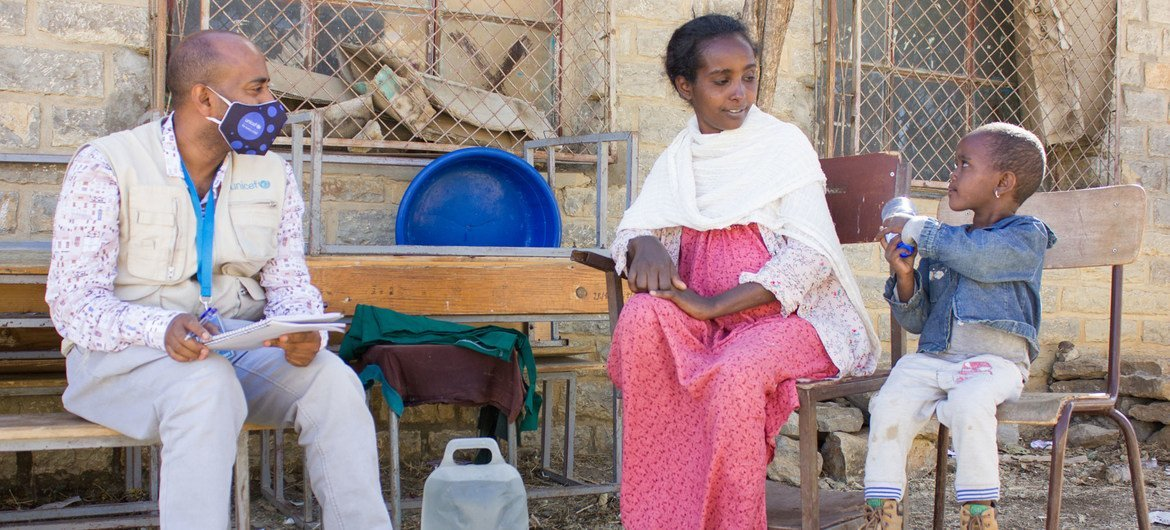 A mother who was displaced from Tigray's western zone talks to a UNICEF worker in the town of Mekelle.