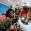 Nana Konadu Agyeman Rawlings, Mke wa Rais wa Ghana, akijibu maswali ya wanahabari wakati wa mkutano wa kimataifa wa wanawake uliofanyika Beijing, China mwezi Septemba mwaka 1995.