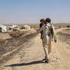 A displaced man who fled his village now lives in a tent settlement on the outskirts of Marib in Yemen.