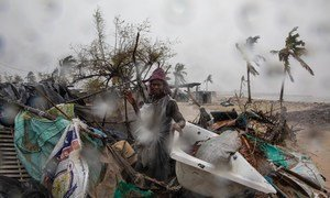 A man stands amidst debris after Tropical Cyclone Eloise barrelled through Mozambique, leaving massive destruction in its wake.