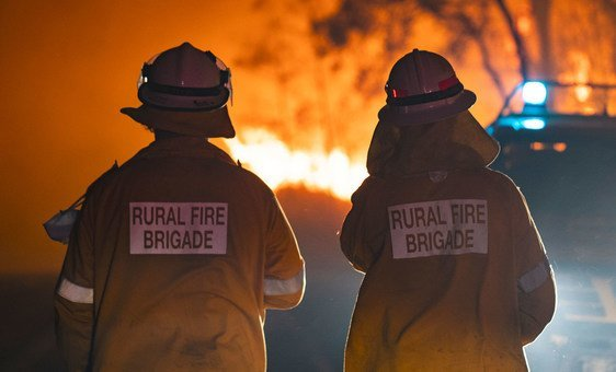 Two firefighters in Queensland, Australia, where the worst wildfires seen in decades are devastating large swathes of the country.