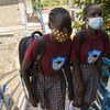 Students at Darling Wisdom Academy in South Sudan walking towards the school  classroom.