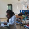 A nurse provides care for cancer patients undergoing chemotherapy in a hospital in Burera District, Rwanda.