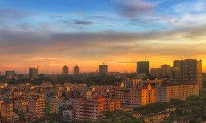 The city skyline of Yangon, Myanmar, at sunset.