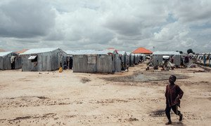 A child walks in front of shelters at an IDP camp in Maiduguri, the capital of Borno state in north-east Nigeria.