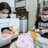 Two young Roma women have been sewing home-made masks that are distributed by civil society groups to social care institutions including old people's homes.