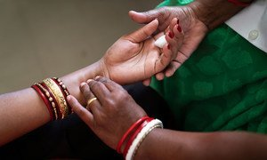 A woman in India visits clinic for a medical examination.