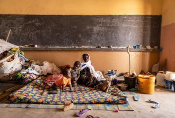 A displaced family from a village in Mali was relocated to a former school.