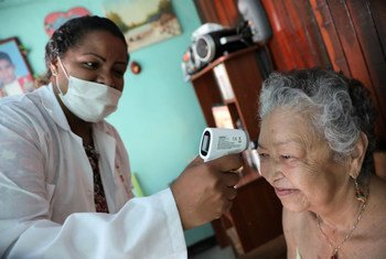Doctors and nurses have been raising awareness about COVID-19 during a house-to-house campaign in the Cuaricao neighbourhood of Caracas, Venezuela.