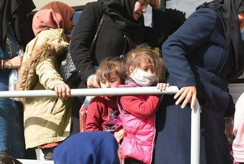 Refugees and migrants gather at the Pazarkule border crossing near Edirne, Turkey, hoping to travel into Greece.