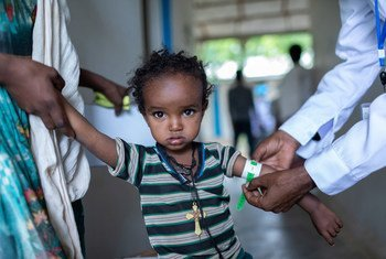 A young girl undergoes a health-check  at a health centre in the Tigray region of northern Ethiopia.