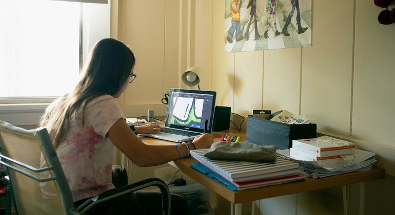 A young girl works on a personal project after completing her schoolwork, at home in Gamboa, Panama.