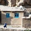 A woman walks in Badakhshan, a province located in north-eastern Afghanistan.