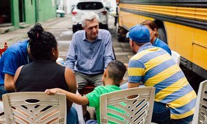 UNHCR High Commissioner Filippo Grandi talks with a Guatemalan family at a shelter in Tapachula, Mexico, on September 28, 2019.