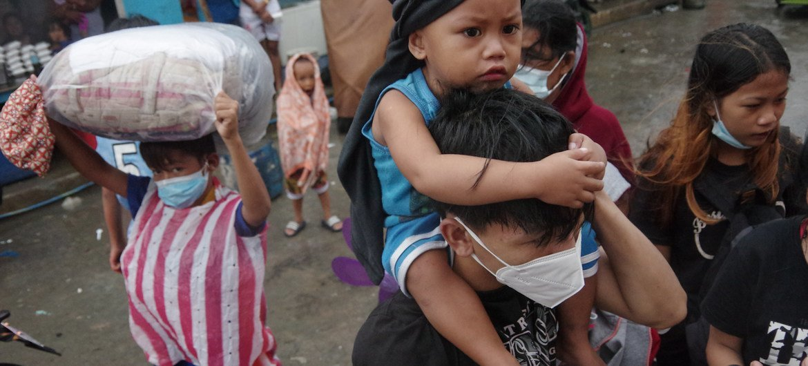 Evacuees arrive at an evacuation center in Manila as super typhoon Goni made landfall in the Philippines on Sunday, November 1, 2020. The typhoon is the strongest one to hit the Philippines in 2020 as the country grapples with the COVID-19 pandemic.