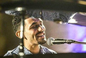 Aeham Ahmed playing piano.