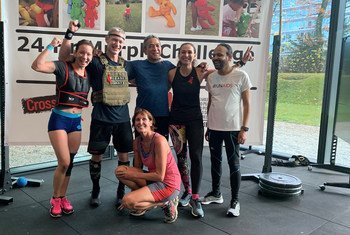 The tireless Peter Koopmans (second left) at the end of his 24-hour challenge at UNAIDS which ended on Monday after a 24-hour ironman challenge.