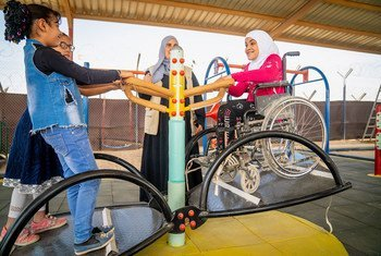 A 9-year-old girl plays on a seesaw in a new inclusive playground built in her school in Za'atari Refugee Camp, Jordan.