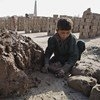 A seven-year-old child working at a brick kiln in Nangarhar province, Afghanistan. His family indebted to the kiln's owner.