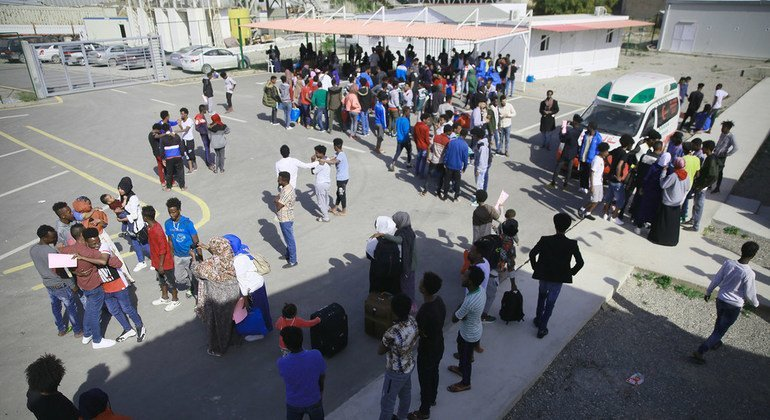 Refugees from Somalia, Syria and Eritrea who have been released from detention centres in Libya, go through the evacuation procedure with staff at UNHCR's Gathering and Departure Facility in Tripoli, Libya.