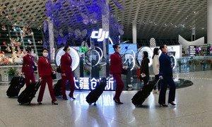 Flight attendants wear face masks at Shenzhen Bao'an International Airport in China.
