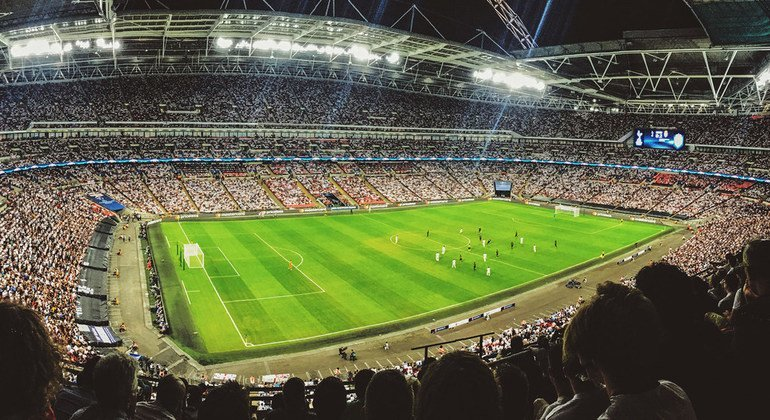 A crowd watching a football game inside Wembley Stadium in England. (September 2016)