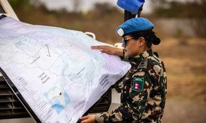A peacekeeper from Nepal deployed to the UN mission in South Sudan, UNMISS, consults a map while on patrol.