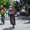 Young men wear face masks while cycling in a park in Büyükçekmece, Turkey.