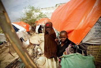 Somali children stand at a camp for Internally Displaced Persons (IDPs) in Mogadishu.