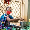 A woman wears a  face mask while working in Gujarat, India.