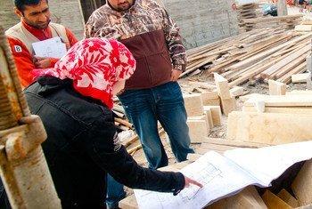 A female engineer checks on a construction site in Amman, Jordan.