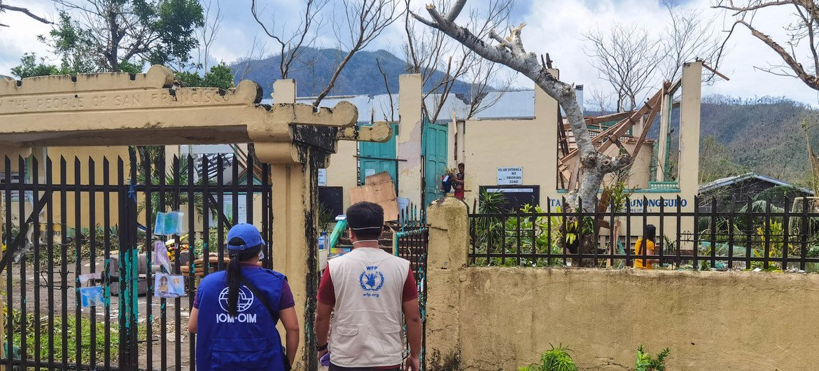 IOM and WFP staff visit a school that served as an evacuation center in San Francisco, Malilipot, Albay whose roof was completely torn off due to the violent winds of Super Typhoon Goni (locally known as Rolly).