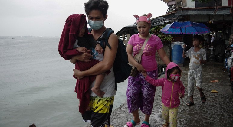 A family leaves their home in Aplaya, near Manila, to seek shelter at an evacuation centre as super typhoon Goni (local name Rolly) makes landfall in the Philippines.