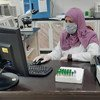 A researcher in a laboratory in Gaza analyzes data as part of efforts to fight the coronavirus.