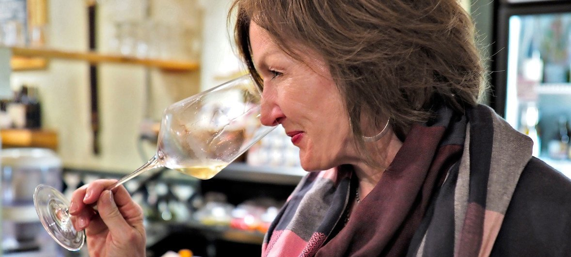 The owner of Swirl Wine Bar and Market, Beth Ribblett, samples a glass of wine.