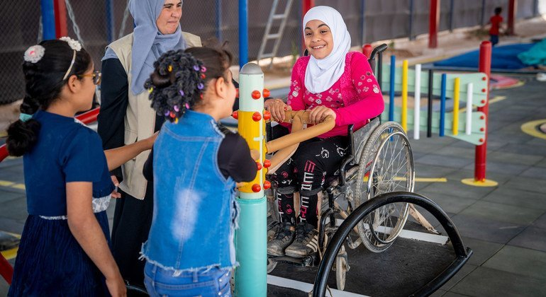 A nine-year-old child plays seesaw with her friends in an inclusive playground at her school in Za'atari Refugee Camp, Jordan.