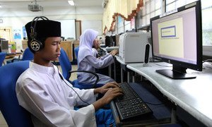 An adolescent boy uses a text-to-speech software to operate a computer at a special education school in Kuala Lumpur, Malaysia.