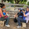 OCHA's Gema Cortés (right) interviews and photographs a woman in Bolivar, Venezuela prior to the outbreak of COVID-19.