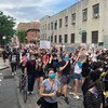 In Brooklyn, New York, protesters peacefully demonstrate against police violence, following the death of George Floyd, in May 2020..