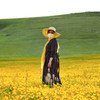 A woman poses in a field in Ardabil, Iran.