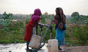 Children collect filtered chlorinated water for drinking purpose from a UNICEF supported water point in Sudan's Blue Nile state, which has been hard hit by the recent flooding.