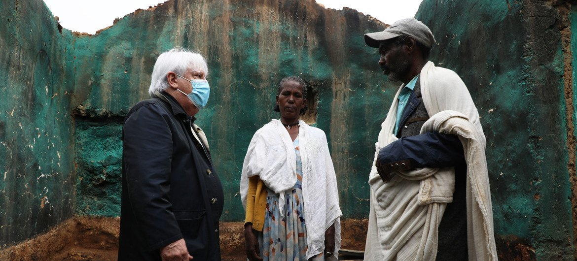 The UN humanitarian chief, Martin Griffiths (left) meets a couple whose house was destroyed in Hawzen, Tigray.
