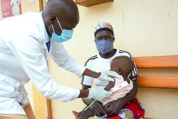A one-year-old baby suffering from malaria receives a health check at a clinic in northern Uganda.