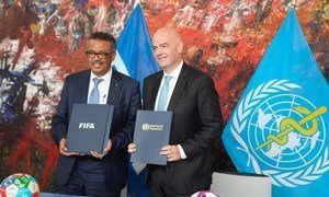 WHO Director-General Dr Tedros Adhanom Ghebreyesus and FIFA President Gianni Infantino sign memorandum of understanding at WHO's Geneva-based headquarters.