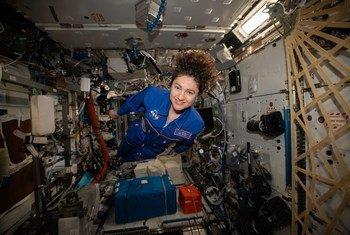 NASA astronaut and Expedition 62 Flight Engineer Jessica Meir hovers for a portrait in the weightless environment of the International Space Station.