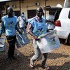 Poll workers carry ballot boxes during the 27 December 2020 presidential elections in the Central African Republic.